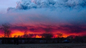 A wildfire moves towards the town of Anzac from Fort McMurray, Alberta., on Wednesday May 4, 2016. Alberta declared a state of emergency Wednesday as crews frantically held back wind-whipped wildfires. Unseasonably hot temperatures combined with dry conditions have transformed the boreal forest in much of Alberta into a tinder box.  (Jason Franson/The Canadian Press via AP) MANDATORY CREDIT