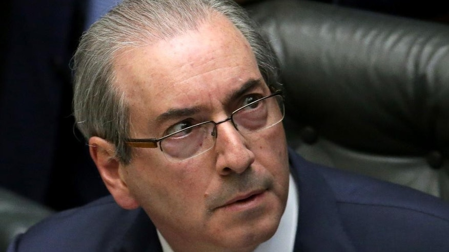 FILE - In this April 15, 2016 file photo, House Speaker Eduardo Cunha attends a debate on whether or not to impeach the president, at the Chamber of Deputies in Brasilia, Brazil. A justice on Brazil's supreme court suspended Cunha, which temporarily removes him. He's been leading the effort to impeach President Dilma Rousseff but himself faces a long list of corruption allegations and is accused by Brazil's chief-prosecutor of obstructing justice. (AP Photo/Eraldo Peres, File)