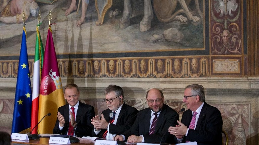 """From left, European Council President Donald Tusk, Professor Joseph Halevi Horowitz Weiler President of the European parliament Martin Schulz and President of the European Commission Jean-Claude Juncker, right, attend the panel discussion """"State of the European Union"""", in Rome, Thursday, May 5, 2016. (AP Photo/Alessandra Tarantino)"""