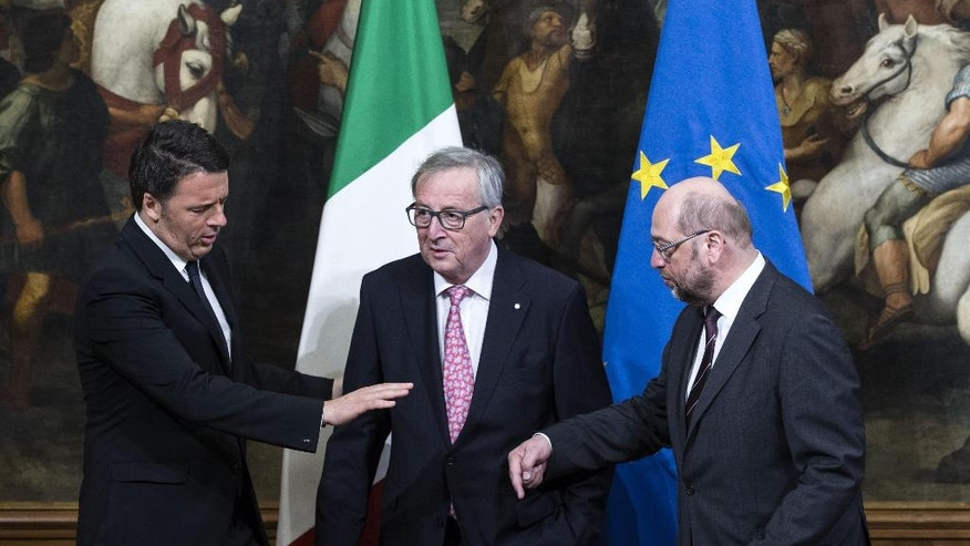 Italy's prime minister Matteo Renzi, left, talks with the president of European Commission Jean-Claude Juncker, center, and the president of the European Parliament Martin Schulz, right, during their meeting in Rome, Thursday, May 5, 2016. (Angelo Carconi/ANSA via AP Photo) ITALY OUT