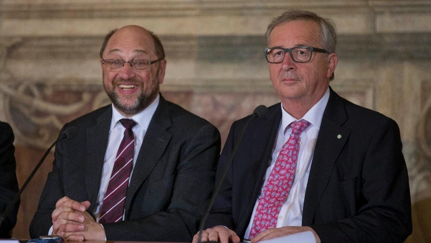 "President of the European parliament Martin Schulz , left, and President of the European Commission Jean-Claude Juncker, right, attend the panel discussion ""State of the European Union"", in Rome, Thursday, May 5, 2016. (AP Photo/Alessandra Tarantino)"