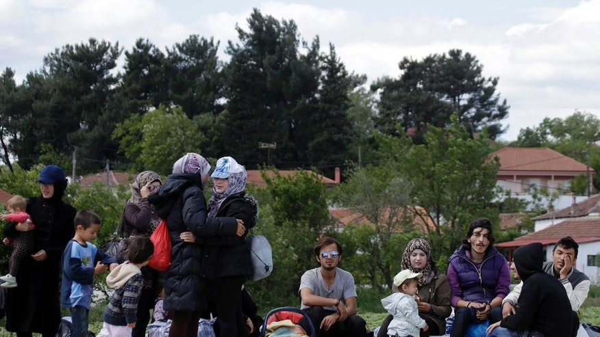 Mohammed Majd Nasser, right, sits with his relatives leaving for the camp of Ladakia at the northern Greek border point of Idomeni, Greece, Thursday, May 5, 2016. The European Union pressed ahead Wednesday with efforts to persuade Turkey to stop asylum seekers from reaching Europe and take back thousands more by offering Turkish citizens the prospect of visa-free travel within the bloc. (AP Photo/Gregorio Borgia)