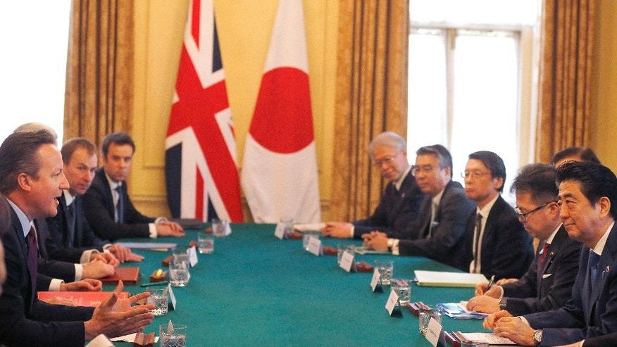 Britain's Prime Minister David Cameron, left, speaks to Japan's Prime Minister Shinzo Abe, right, as they meet at 10 Downing Street in London, Thursday, May 5, 2016. (AP Photo/Frank Augstein, Pool)
