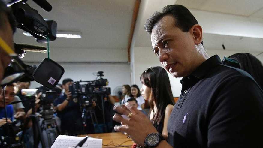 Philippine senator and vice presidential candidate Senator Antonio Trillanes IV gestures as he answers questions from reporters in suburban Quezon city, north of Manila, Philippines on Thursday, May 5, 2016. Senator Trillanes has filed a corruption complaint against the presidential race front runner Davao City Mayor Rodrigo Duterte alleging he charged salaries for 11,000 non-existent government employees. (AP Photo/Aaron Favila)