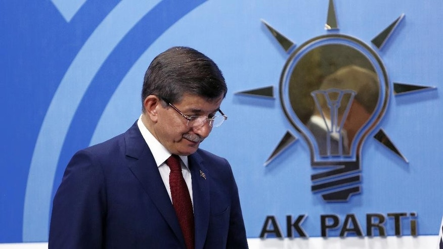Turkish Prime Minister Ahmet Davutoglu leaves after a press conference at the headquarters of his ruling Justice and Development Party, AKP, in Ankara, Turkey, Thursday, May 5, 2016. Davutoglu announced his resignation on Thursday, paving the way for the country's president to pursue a tighter grip on power. (AP Photo/Burhan Ozbilici)