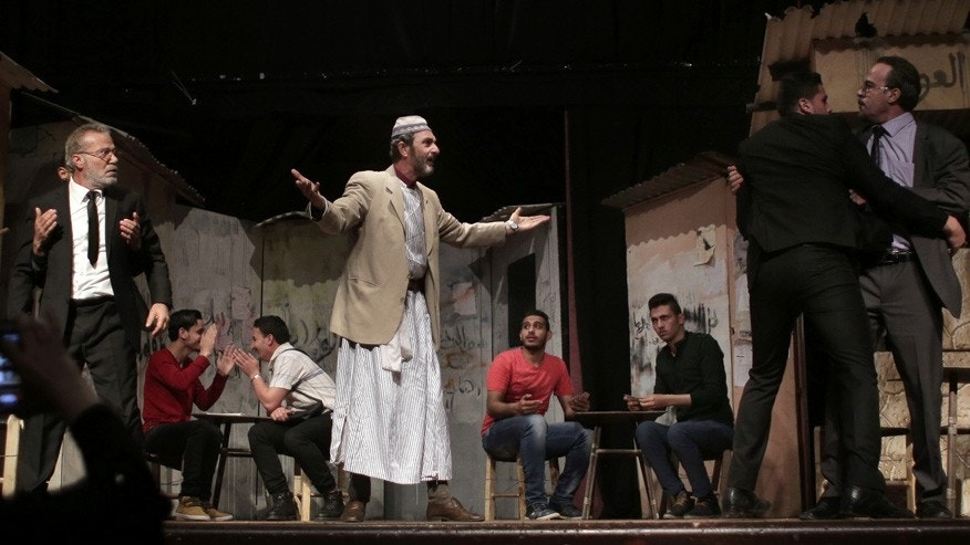 "April 28, 2016: Palestinian actors perform a Gaza version of Shakespeare's ""Romeo and Juliet"" play on the stage of a cultural center in Gaza City."