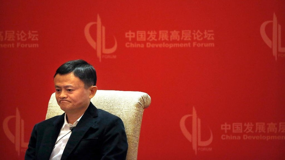 In this March 19, 2016 photo, Jack Ma, executive chairman of the Alibaba Group, listens to a speaker during a panel discussion held as part of the China Development Forum at the Diaoyutai State Guesthouse in Beijing. The International Anti-Counterfeiting Coalition's decision to welcome Chinese e-commerce giant Alibaba as a new member - and allow founder Jack Ma to make the keynote speech at its May 2016 conference - so incensed the U.S. luxury retailer Michael Kors that it severed its longstanding connection with the Washington-based industry group. (AP Photo/Mark Schiefelbein)
