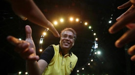 FILE - In this April 28, 2016, file photo, Philippine Presidential Mar Roxas, former Interior and local government secretary, reaches out to greet supporters during a campaign sortie in suburban Quezon city, north of Manila, Philippines. A U.S.-educated investment banker and the richest Philippine presidential aspirant, Roxas lacks the dramatic life stories of his rivals, including a tough-talking mayor with a public vow to dump criminals in Manila Bay and a foundling who made it big in politics. (AP Photo/Aaron Favila, File)