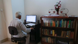 In this Tuesday, May 3, 2016 photo, Dhaka University professor Azizur Rahman works on his computer at his home in Dhaka, Bangladesh. Rahman is among a growing number of political moderates and intellectuals seeking protection in Bangladesh, where at least 15 writers, activists, religious minorities and foreign aid workers have been killed in targeted attacks since the start of 2015. Islamist extremists have claimed responsibility for the killings, which have prompted some Bangladeshis to go into hiding, and others to seek asylum in the United States and European countries including Germany, Sweden and Switzerland. (AP Photo)