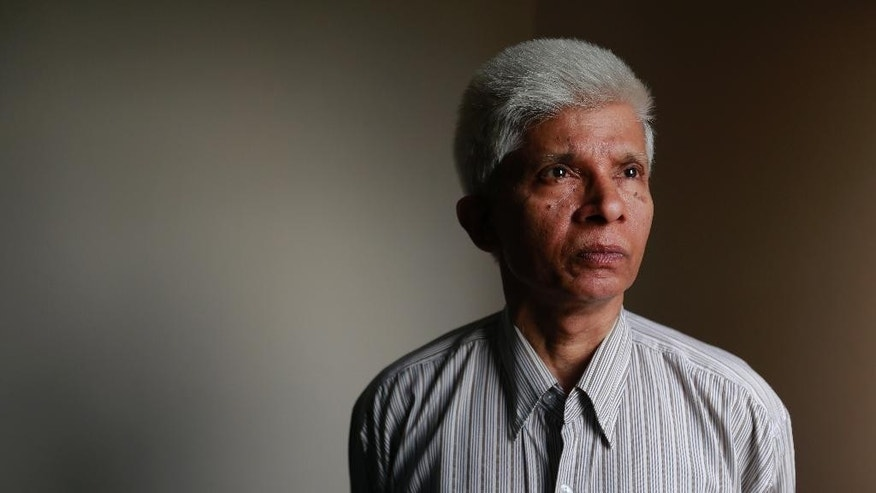 In this Tuesday, May 3, 2016 photo, Dhaka University professor Azizur Rahman poses for a portrait at his home in Dhaka, Bangladesh. Rahman is among a growing number of political moderates and intellectuals seeking protection in Bangladesh, where at least 15 writers, activists and religious minorities have been hacked to death since the start of 2015. The government says the political opposition orchestrated the attacks to stir chaos, though the opposition denies it and says it is being scapegoated. The government denies any involvement by transnational jihadist groups, though all 15 attacks have been claimed by the Islamic State group or various al-Qaida affiliates in Bangladesh. (AP Photo)