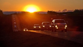Evacuees leave Fort McMurray in the early morning, after being stranded north of wildfire in Fort McMurray, Alberta, Canada on Friday, May 6, 2016. The Alberta provincial government, which declared a state of emergency, said more than 1,100 firefighters, 145 helicopters, 138 pieces of heavy equipment and 22 air tankers were fighting the fire, but Chad Morrison, Alberta's manager of wildfire prevention, said rain is needed.  (Jason Franson/The Canadian Press via AP) MANDATORY CREDIT