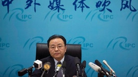 """Ouyang Yujing, Director-General of the Department of Boundary and Ocean Affairs of China's Ministry of Foreign Affairs, speaks during a press briefing about China's South China Sea policies in Beijing, Friday, May 6, 2016. China is rallying Russia and other friendly states to back a push to exclude the U.S. and its allies from the festering South China Sea dispute, despite its insistence that countries without a direct territorial claim should remain firmly neutral. The words, above, mean """"Chinese and foreign media briefing."""" (AP Photo/Mark Schiefelbein)"""