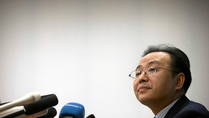 Ouyang Yujing, Director-General of the Department of Boundary and Ocean Affairs of China's Ministry of Foreign Affairs, listens to a question during a press briefing about China's South China Sea policies in Beijing, Friday, May 6, 2016. China is rallying Russia and other friendly states to back a push to exclude the U.S. and its allies from the festering South China Sea dispute, despite its insistence that countries without a direct territorial claim should remain firmly neutral. (AP Photo/Mark Schiefelbein)