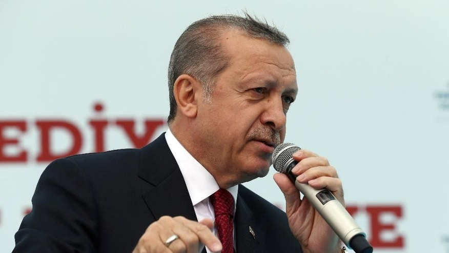Turkey's President Recep Tayyip Erdogan addresses his supporters during an opening ceremony in Istanbul, Friday, May 6, 2016. Turkish Prime Minister Ahmet Davutoglu, who had fallen out with Erdogan, announced his resignation on Thursday, paving the way for Erdogan to pursue a tighter grip on power. (Basin Bulbul, Presidential Press Service, Pool via AP)