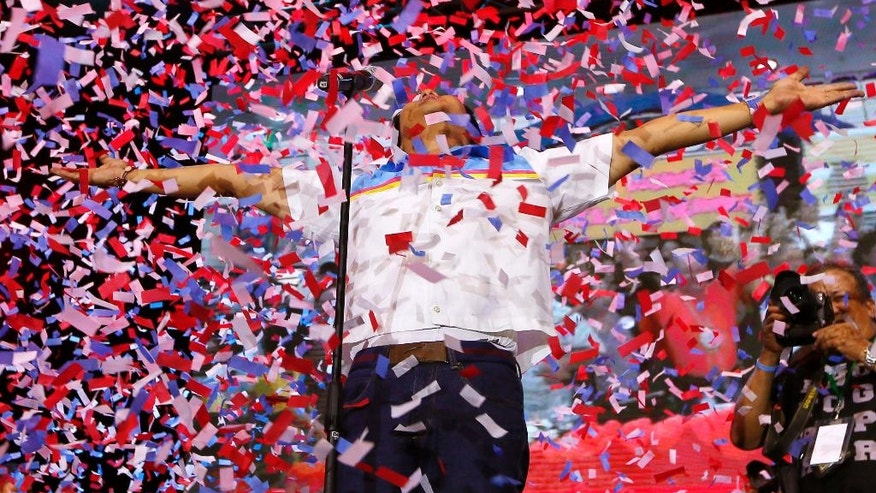 """Confetti rain on Vice Presidential candidate Sen. Ferdinand """"Bongbong"""" Marcos Jr., as he is introduced to supporters on his last campaign rally for Monday's presidential elections Thursday, May 5, 2016 at suburban Mandaluyong city east of Manila, Philippines. Marcos, the son of the late Philippine strongman Ferdinand Marcos, is in a """"statistical tie"""" with vice presidential candidate Leni Robredo in poll surveys leading to May 9 elections.(AP Photo/Bullit Marquez)"""