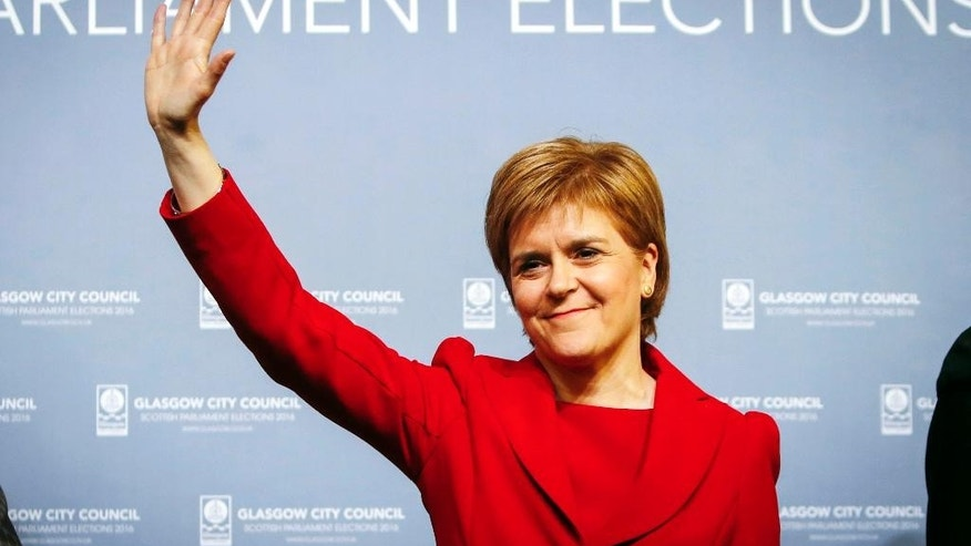 Scottish National Party  leader Nicola Sturgeon celebrates after retaining her seat at a Scottish Parliament election count in Glasgow, Scotland Friday May 6, 2016. Voters punished the opposition Labour Party in Scotland as the first results rolled for local and regional elections across the United Kingdom.  (Danny Lawson/PA via AP) UNITED KINGDOM OUT