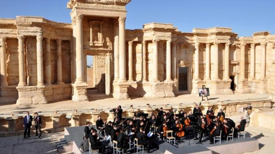 Russian orchestra performs in Palmyra as airstrike on ...