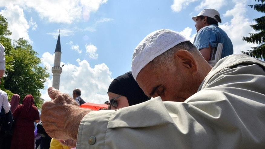 Bosnian people prayer during the opening ceremony of the Ferhat Pasha mosque in Banja Luka, Bosnia, on Saturday, May 7, 2016. Over 10,000 people turned out Saturday for the re-opening of a mosque in Bosnia that was blown up by Christian Orthodox Serbs during the 1992-1995 war and that became a symbol of the effort to destroy Bosnia's centuries-long multireligious fabric. (AP Photo/Radivoje Pavicic)