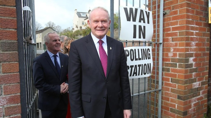 Sinn Fein's Martin McGuinness arrives at a polling station at Model Primary School in Londonderry, Northern Irelandd  as polls open for the Northern Ireland Assembly election Thursday May 5, 2016. Voters are electing a Scottish Parliament, legislatures in Wales and Northern Ireland as well as choosing many English local authorities.   (Niall Carson/PA via AP) UNITED KINGDOM OUT