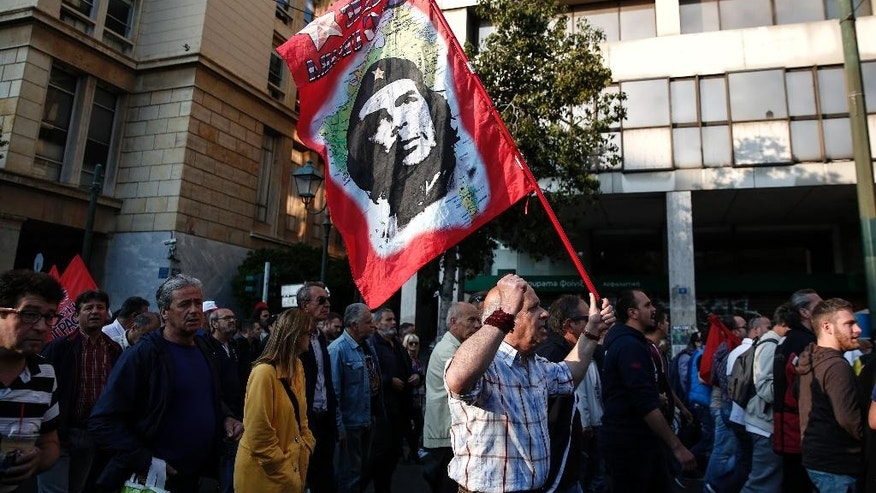 Supporters of the communist-affiliated union PAME chant slogans during an anti-austerity rally in Athens, Saturday, May 7, 2016. More than 20,000 slogan-chanting, pro-communist protesters have taken to the streets of Athens to protest against the left-led government's pension and tax reform bill, which is being debated in Parliament. (AP Photo/Yorgos Karahalis)