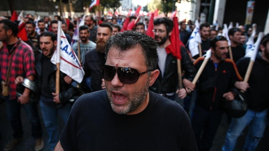 Supporters of the communist-affiliated union PAME chant slogans during an anti-austerity rally in Athens, on Saturday, May 7, 2016. More than 20,000 slogan-chanting, pro-communist protesters have taken to the streets of Athens to protest against the left-led government's pension and tax reform bill, which is being debated in Parliament. (AP Photo/Yorgos Karahalis)