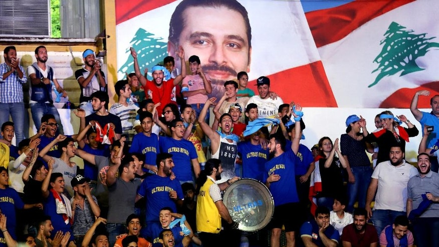In this picture taken on Thursday, May 5, 2016, supporters of former Lebanese Prime Minister Saad Hariri, leader of Lebanon's parliamentary majority, chant slogans for the list that Hariri's group support, which is called Beirutis' list, during an rally for the Municipality elections, in Beirut, Lebanon. (AP Photo/Hussein Malla)