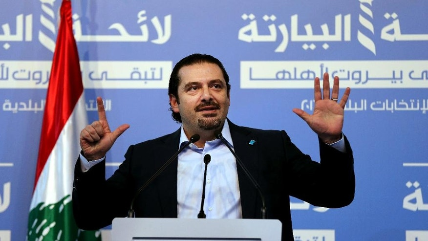 In this picture taken on Thursday, May 5, 2016, former Lebanese Prime Minister Saad Hariri, leader of Lebanon's parliamentary majority, asks his supporters to be at the ballot stations at 7 o'clock in the morning and vote for the list that his group support which is called Beirutis' list, as he addresses an election rally for the Municipality elections, in Beirut, Lebanon. (AP Photo/Hussein Malla)