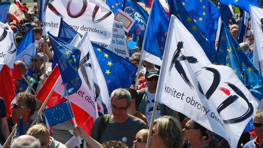 Opponents of Poland's conservative government march downtown streets to protest the country's direction under a conservative government that is accused of eroding the rule of law, in Warsaw, Poland, Saturday, May 7, 2016. The protest is also meant as a show of support for European values and the country's membership in the EU.(AP Photo/Czarek Sokolowski)