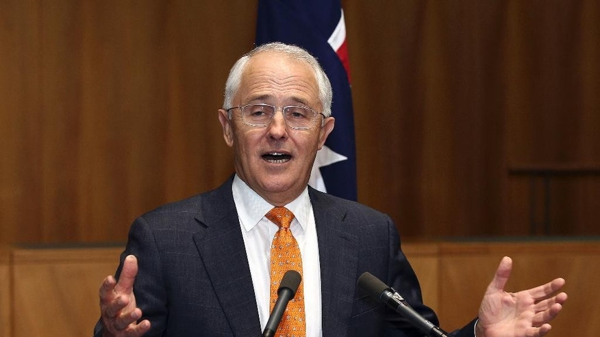 Prime Minister Malcolm Turnbull holds his hands out wide as he speaks to the media during a press conference at Parliament House in Canberra, Australia, Sunday, May 8, 2016. Turnbull officially announced a double dissolution election on July 2, 2016 and put economic management at the forefront of his campaign to win a second three-year term for his conservative coalition during era of extraordinary volatility in Australian politics. (AP Photo/Rob Griffith)