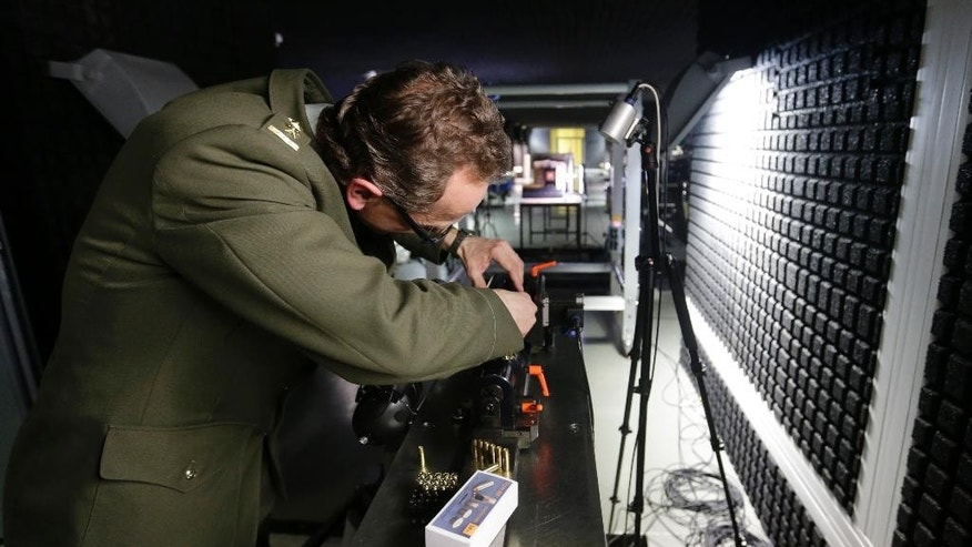In this picture taken on Wednesday, April 13, 2016, Lt. Col. Roman Vitek loads a ballistic rifle with hollow point bullets during a demonstration at a underground research facility at the University of Defense in Brno, Czech Republic. Researchers at the university have optimized existing hollow point bullets to serve air marshals. (AP Photo/Petr David Josek)