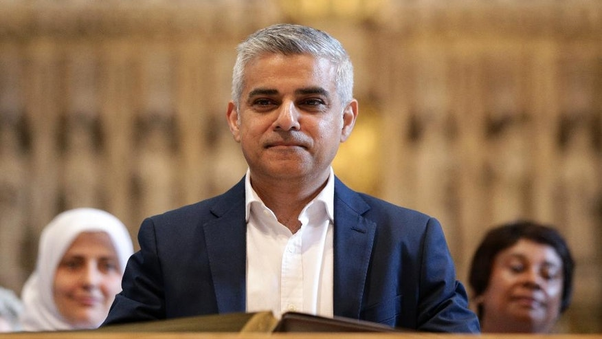 London's new mayor Sadiq Khan attends the official signing ceremony in Southwark Cathedral, London, Saturday May 7, 2016. On Friday the 45-year-old Labour Party politician became the first person of Islamic faith to lead Europe's largest city. (Yui Mok/Pool via AP)