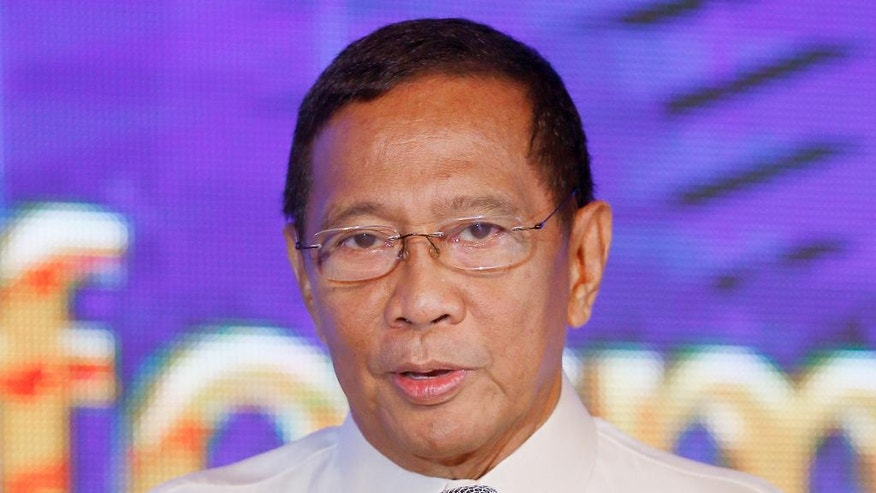 FILE - In this file photo taken on Oct. 27, 2015, Philippine Vice President Jejomar Binay talks about his economic platform during a dialogue with the country's business sector in suburban Pasay city south of Manila, Philippines. Binay is one of five candidates in Monday's Philippine presidential election. The next Philippine president will inherit daunting security problems, including territorial rifts with China, Muslim and communist insurgencies and law and order concerns. (AP Photo/Bullit Marquez, File)
