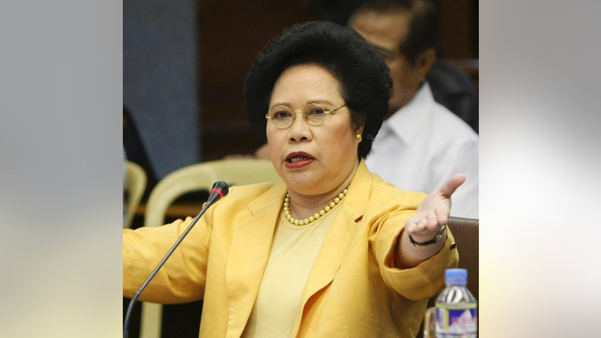 FILE - In this file photo taken July 13, 2011, Senator Miriam Defensor Santiago gestures during a Philippine Senate hearing in Manila, Philippines. Defensor Santiago is one of five candidates in Monday's Philippine presidential election. The next Philippine president will inherit daunting security problems, including territorial rifts with China, Muslim and communist insurgencies and law and order concerns. (AP Photo/Bullit Marquez, File)
