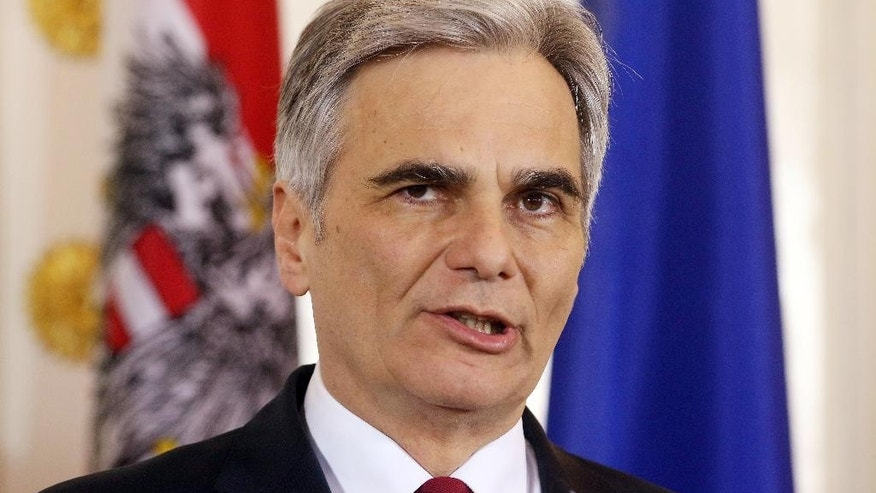 FILE - In this March 1, 2016 file photo Austrian Chancellor Werner Faymann addresses the media during a news conference after talks with European Council President Donald Tusk at the federal chancellery in Vienna, Austria. Faymann announced Monday, May 9, 2016 that he will step back from all his posts. (AP Photo/Ronald Zak, file)