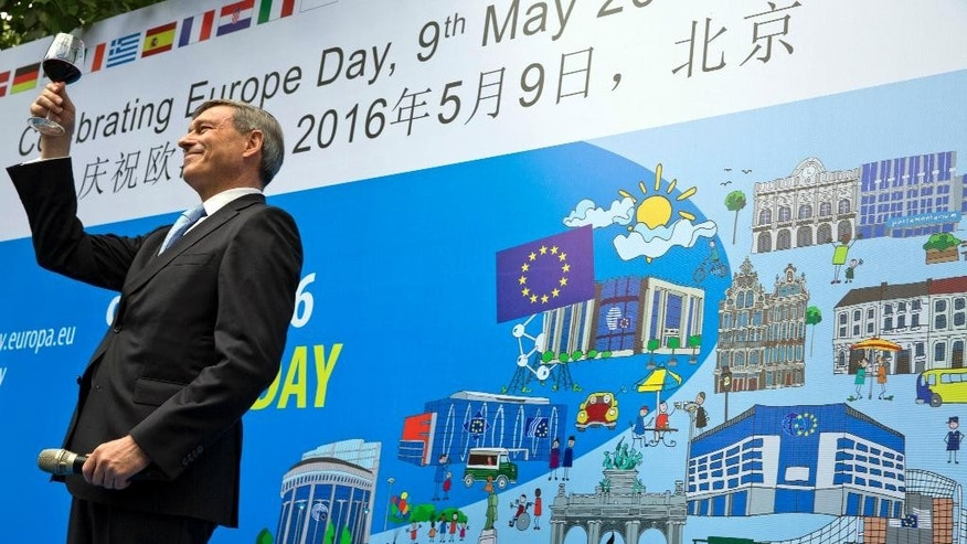 Hans Dietmar Schweisgut, EU ambassador to China, toasts after delivering the opening speech at an event to mark Europe Day in Beijing, China, Monday, May 9, 2016. (AP Photo/Ng Han Guan)