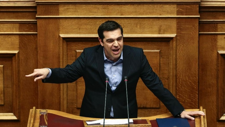 Greece's Prime Minister Alexis Tsipras addresses lawmakers during a parliamentary session in Athens, on Sunday, May 8, 2016. Greek anarchists hurled firebombs, chairs and wooden planks at riot police in brief clashes outside parliament while lawmakers were debating a controversial austerity bill, disrupting a much larger peaceful rally on Sunday. (AP Photo/Yorgos Karahalis)