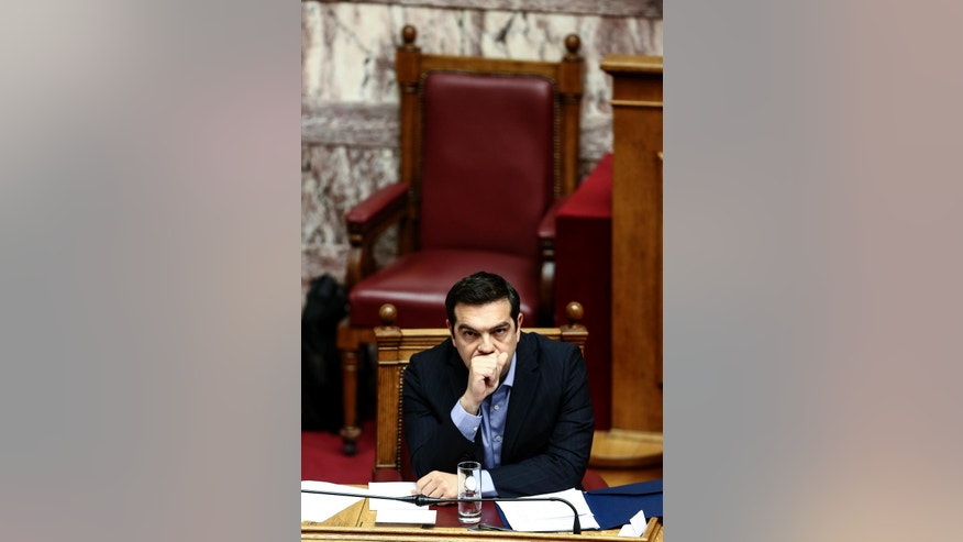 Greece's Prime Minister Alexis Tsipras attends a parliamentary session in Athens, Sunday, May 8, 2016. Greek anarchists hurled firebombs, chairs and wooden planks at riot police in brief clashes outside parliament while lawmakers were debating a controversial austerity bill, disrupting a much larger peaceful rally on Sunday. (AP Photo/Yorgos Karahalis)
