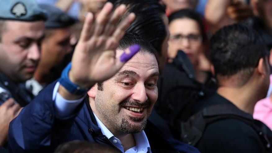 Former Lebanese Prime Minister Saad Hariri, leader of Lebanon's parliamentary majority, waves to his supporters after casting his ballot during the Municipal Elections, outside a voting station, in Beirut, Lebanon, Sunday, May 8, 2016. The Municipality Elections take place today in Beirut and in the Bekaa valley with an outsider group of candidates challenging a political establishment widely seen as corrupt and incompetent. (AP Photo/Hussein Malla)