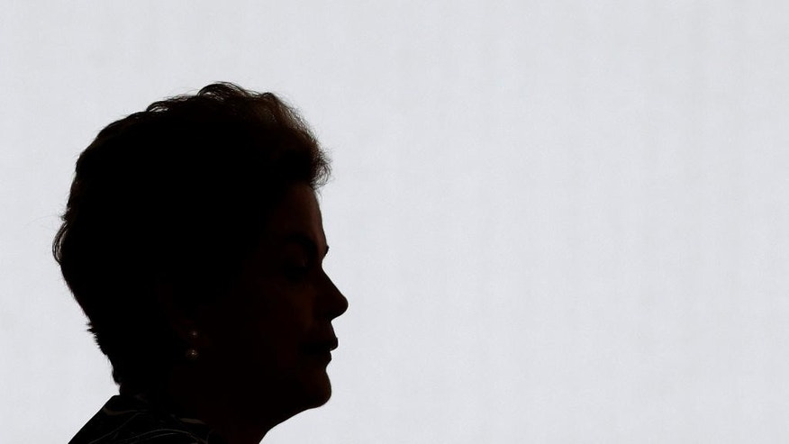 In this May 6, 2016 photo, Brazil's President Dilma Rousseff arrives to attends the ceremony of the Program My home, My life, at the Planalto Presidential Palace, in Brasilia, Brazil. The Senate's impeachment commission vote today on whether to recommend impeaching Rousseff, with the decisive vote by the full Senate slated for next Wednesday. (AP Photo/Eraldo Peres)