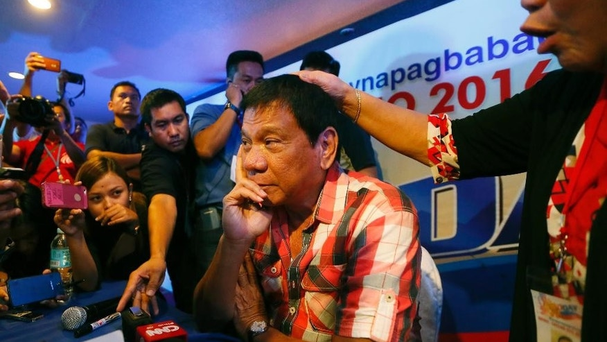 Philippines presidential candidate Rodrigo Duterte with supporters on Monday.