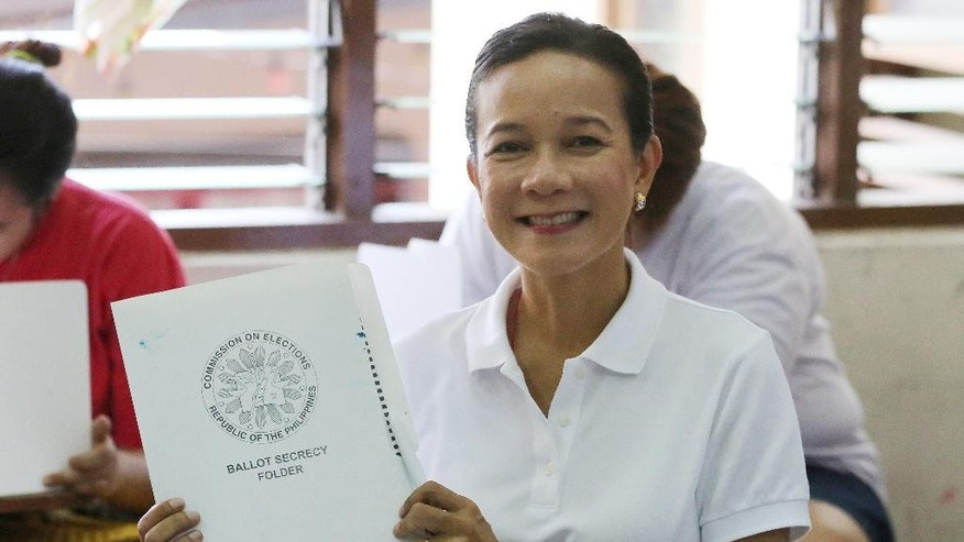 Philippine presidential candidate Grace Poe displays her ballot.