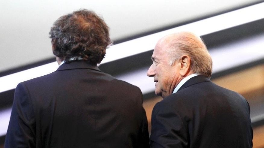 FILE - In this June 1, 2011 file photo then FIFA President Joseph Blatter, right, and then UEFA President Michel Platini walk together at the 61st FIFA Congress in Zurich, Switzerland. The Court of Arbitration for Sport, CAS, in Lausanne, Switzerland, plans to announce its verdict on Monday, May 9, 2016 in Michel Platini's appeal on his six-year ban from football.  (AP Photo/Michael Probst, file)