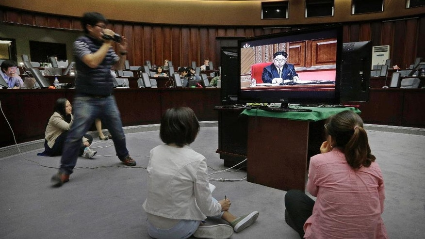 FILE - In this May 7, 2016, file photo, foreign journalists watch a broadcast of the second day of the 7th Congress of the Workers' Party of Korea on local television in Pyongyang, North Korea. North Korea brought in more than 100 journalists from around the world to make sure the 7th Congress of its ruling party gets global attention, but has only allowed the trusted state-run media inside. (AP Photo/Wong Maye-E, File)