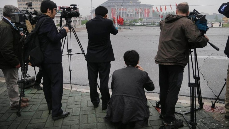 FILE - In this May 6, 2016, file photo, foreign journalists photograph the April 25 House of Culture, the venue for the 7th Congress of the Workers' Party of Korea, in Pyongyang, North Korea. North Korea brought in more than 100 journalists from around the world to make sure the 7th Congress of its ruling party gets global attention, but has only allowed the trusted state-run media inside, and kicked one foreigner out of the country. (AP Photo/Wong Maye-E, File)