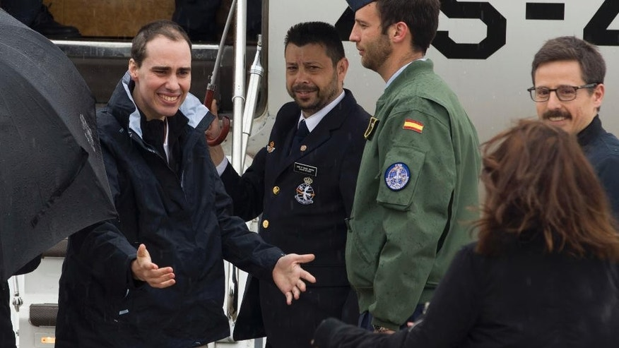 In this photo made available by Presidencia del Gobierno on Sunday, May 8, 2016, Spanish journalist Antonio Pampliega, left, arrives at the Torrejon military airbase in Madrid, Spain. Three Spanish journalists who went missing while working in Syria in July were freed from captivity, the Spanish government said on Saturday. Antonio Pampliega, Jose Manuel Lopez and Angel Sastre disappeared near the city of Aleppo in northern Syria on July 12. (Pool Moncloa via AP)