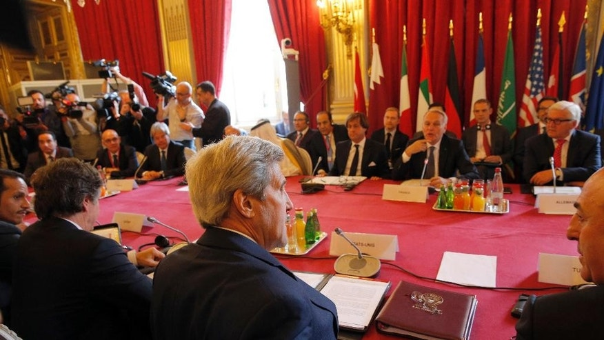 U.S. Secretary of State John Kerry, foreground center, attends a meeting on the conflict in Syria in Paris, Monday, May 9, 2016. Representatives of Britain, Germany, Italy, Saudi Arabia, UAE, Qatar, Jordan, Turkey and the EU have also been invited in Paris Monday for a meeting in the presence of the Riad Hijab, head of the Western-backed Syrian opposition coalition, in an effort to re-launch the Syrian peace process.(AP Photo/Christophe Ena)