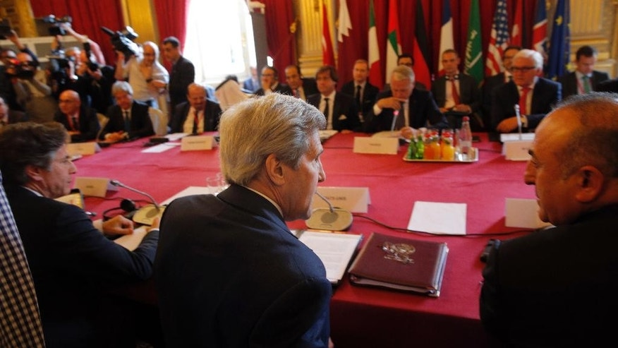Secretary of State John Kerry, center, attends a meeting on the conflict in Syria in Paris, Monday, May 9, 2016. Representatives of Britain, Germany, Italy, Saudi Arabia, UAE, Qatar, Jordan, Turkey and the EU have also been invited in Paris Monday for a meeting in the presence of the Riad Hijab, head of the Western-backed Syrian opposition coalition, in an effort to relaunch the Syrian peace process.(AP Photo/Christophe Ena)