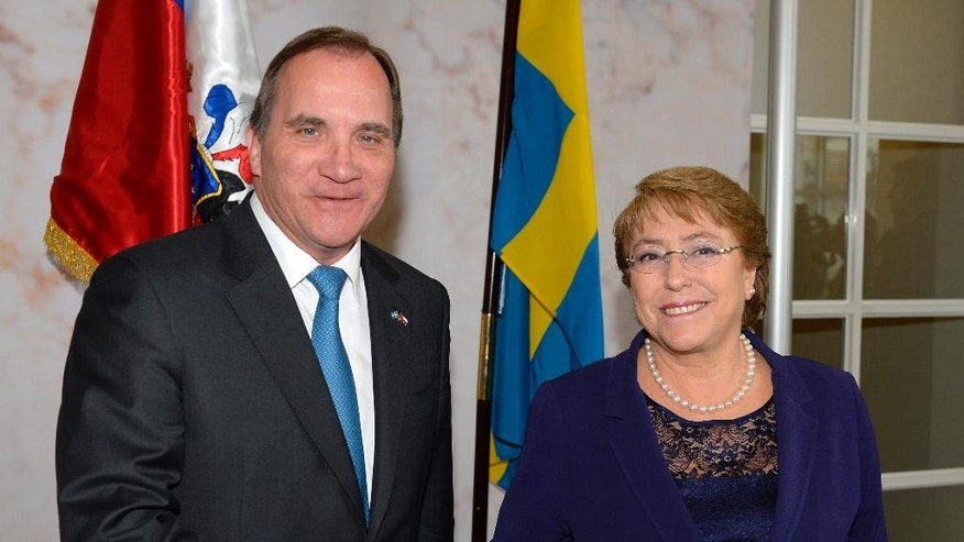 Sweden's Prime Minister Stefan Lofven welcomes Chilean President Michelle Bachelet to the Government headquarters in Stockholm, Sweden,  Tuesday May 10, 2016. President Bachelet started a three day long official visit to Sweden Tuesday. (Anders Wiklund / TT  via AP)  SWEDEN OUT