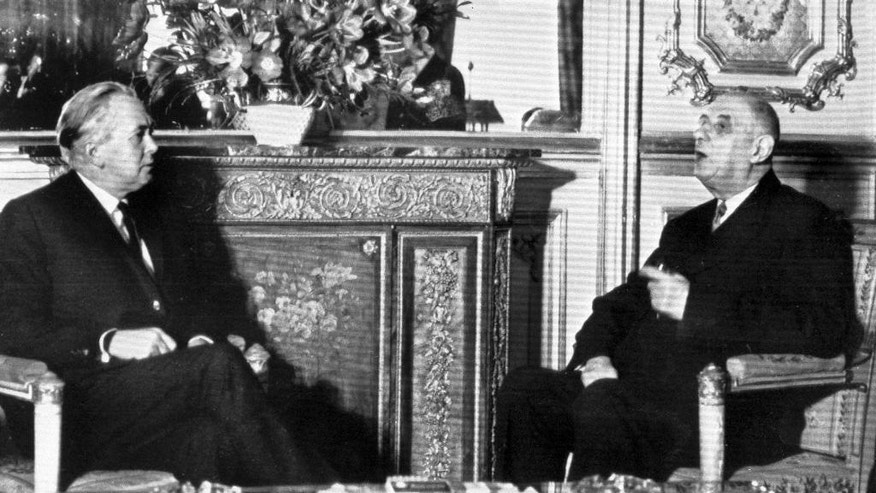 FILE - In this Jan. 24, 1967 file photo, British Prime Minister Harold Wison, left, sits in a room of the the Elysee Palace in Paris, France with French President Charles de Gaulle. Later that year, de Gaulle would veto Britain's efforts to join the-then European Economic Community. It was only after de Gaulle's death that Britain eventually joined the EEC in 1973. Britain holds a vote on June 23, 2016 to decide whether to stay in the European Union. (AP Photo, File)