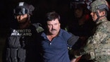 """FILE - In this Jan. 8, 2016 file photo, Mexican drug lord Joaquin """"El Chapo"""" Guzman is escorted by army soldiers  to a waiting helicopter, at a federal hangar in Mexico City, after he was recaptured from breaking out of a maximum security prison in Mexico. The History channel says it's developing a drama series focusing on Guzman's story. Last year, Guzman had broken out of prison and was on the run when he had a secret meeting with Mexican actress Kate del Castillo and Sean Penn. The actor wrote about it for Rolling Stone. (AP Photo/Rebecca Blackwell, File)"""